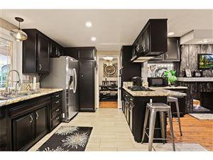 Photo of 7843 WOODLAKE Avenue, West Hills, CA 91304 (MLS # SR17259737)