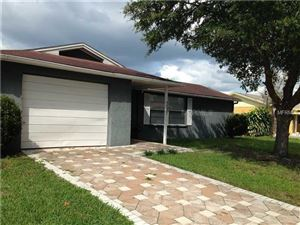 Photo of 7051 FIRESIDE DR, PORT RICHEY, FL 34668 (MLS # T2915046)