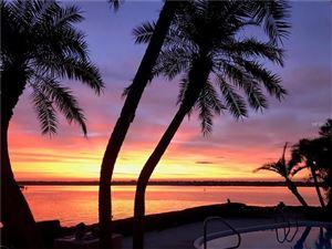 Photo of 235 HOWARD DR, BELLEAIR BEACH, FL 33786 (MLS # U7837159)