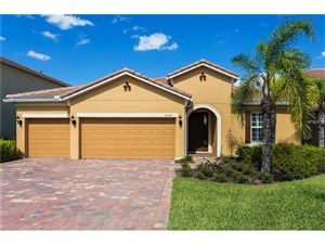 Photo of 12143 AZTEC ROSE LN, ORLANDO, FL 32827 (MLS # O5522310)