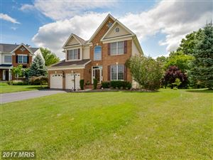 Photo of 5693 OLYMPIA FIELDS PL, HAYMARKET, VA 20169 (MLS # PW10033053)
