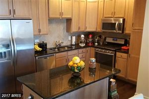 Photo of 23530 HOPEWELL MANOR TER #23530, ASHBURN, VA 20148 (MLS # LO10063107)