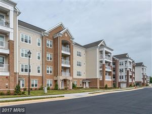 Photo of 20515 LITTLE CREEK TER #207, ASHBURN, VA 20147 (MLS # LO10063287)