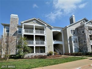 Photo of 1716 LAKE SHORE CREST DR #34, RESTON, VA 20190 (MLS # FX9900607)