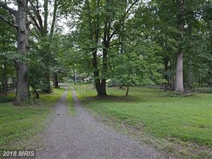 Photo of 215 DEEPWOODS DR, GREAT FALLS, VA 22066 (MLS # FX9730750)