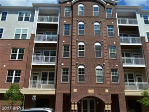 Photo of 13724 NEIL ARMSTRONG AVE #305, HERNDON, VA 20171 (MLS # FX10006757)