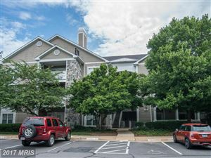 Photo of 1712 LAKE SHORE CREST DR #12, RESTON, VA 20190 (MLS # FX9971808)