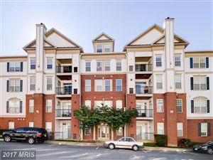Photo of 11635 CAVALIER LANDING CT #401, FAIRFAX, VA 22030 (MLS # FX10085935)