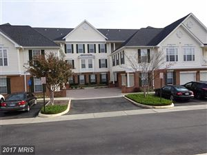 Photo of 25340 LAKE MIST SQ #204, CHANTILLY, VA 20152 (MLS # LO10106952)