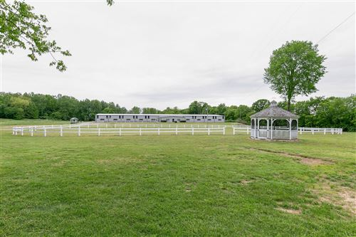 Photo of Many potential uses for this property!  Currently used as Horse Training Facility, Training Barns, Indoor Arena, Office.  Beautiful building site with mature trees.  City water available.