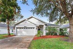 Photo of 149 HAWTHORN HEDGE LN, JACKSONVILLE, FL 32259 (MLS # 909893)