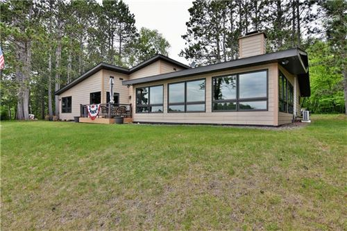 Photo of N67W30867 GOLF RD, HARTLAND, WI 53029 (MLS # 1554261)