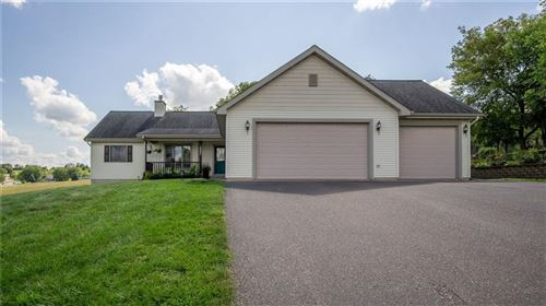 Photo of N17W26840 E FIELDHACK DR #F, PEWAUKEE, WI 53072 (MLS # 1557729)