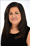 Almas Devshi, Realm Real Estate Professional