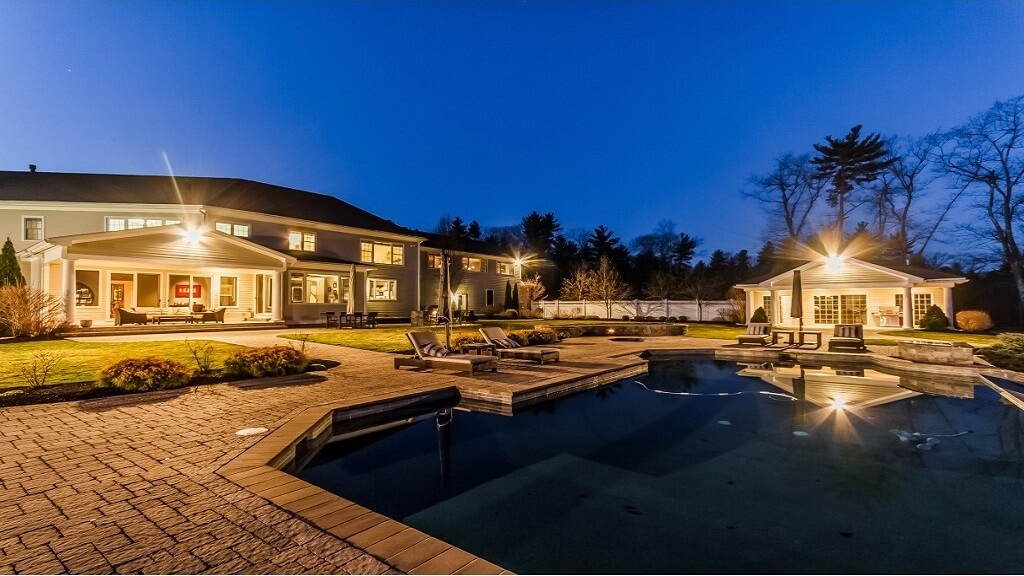 Luxury home with pool at dusk 1024x576