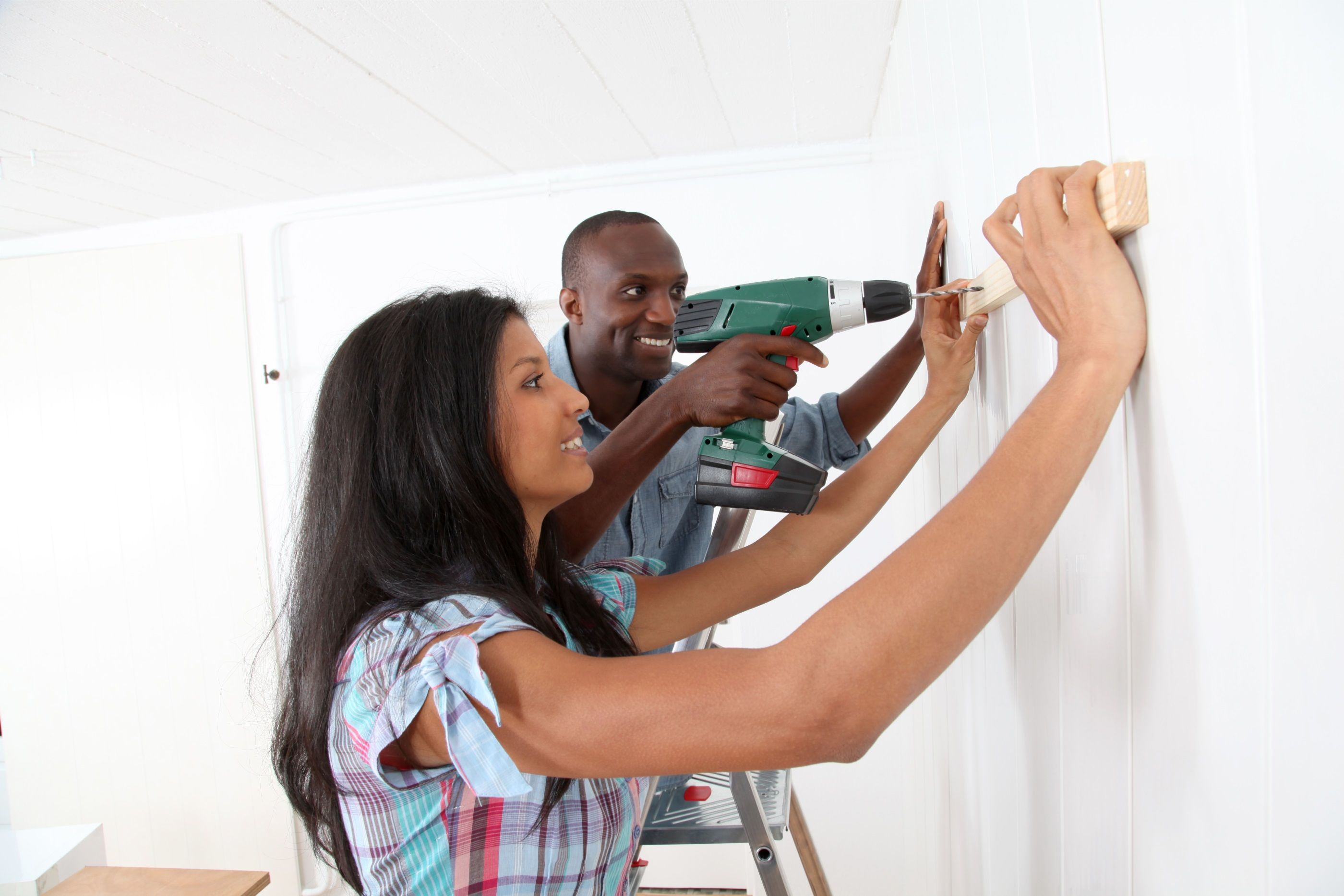 Couple Working on Home Project
