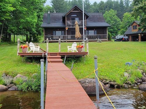 Photo of 23 Lake Simond Road, Tupper Lake, NY 12986 (MLS # 173951)