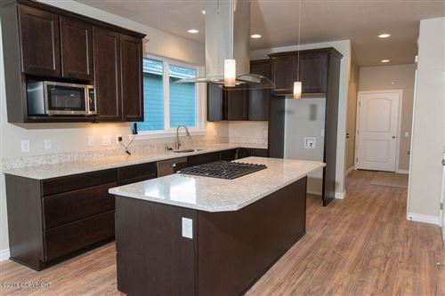 Photo of 611 Pacific Place #8, Anchorage, AK 99501 (MLS # 21-11909)