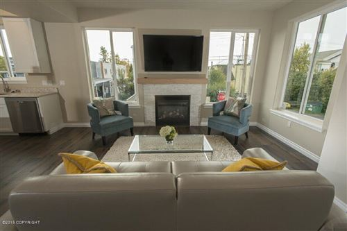 Photo of 615 Pacific Place #10, Anchorage, AK 99501 (MLS # 21-11910)