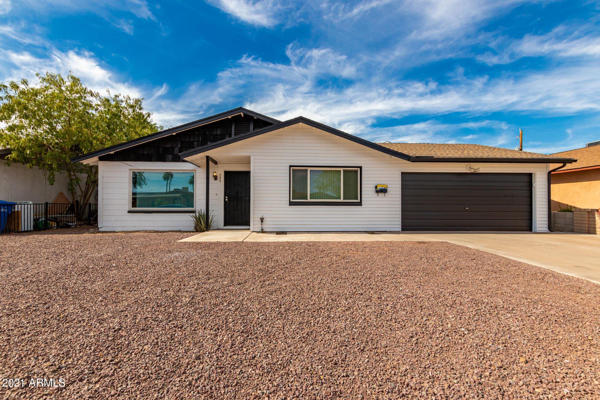 Photo of 5302 W LEWIS Avenue, Phoenix, AZ 85035 (MLS # 6250049)