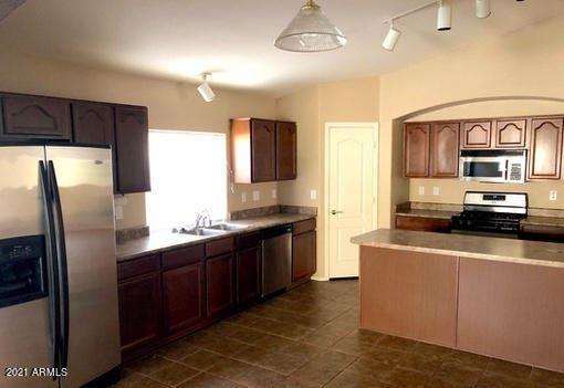 Photo of 42632 W OAKLAND Drive, Maricopa, AZ 85138 (MLS # 6200089)