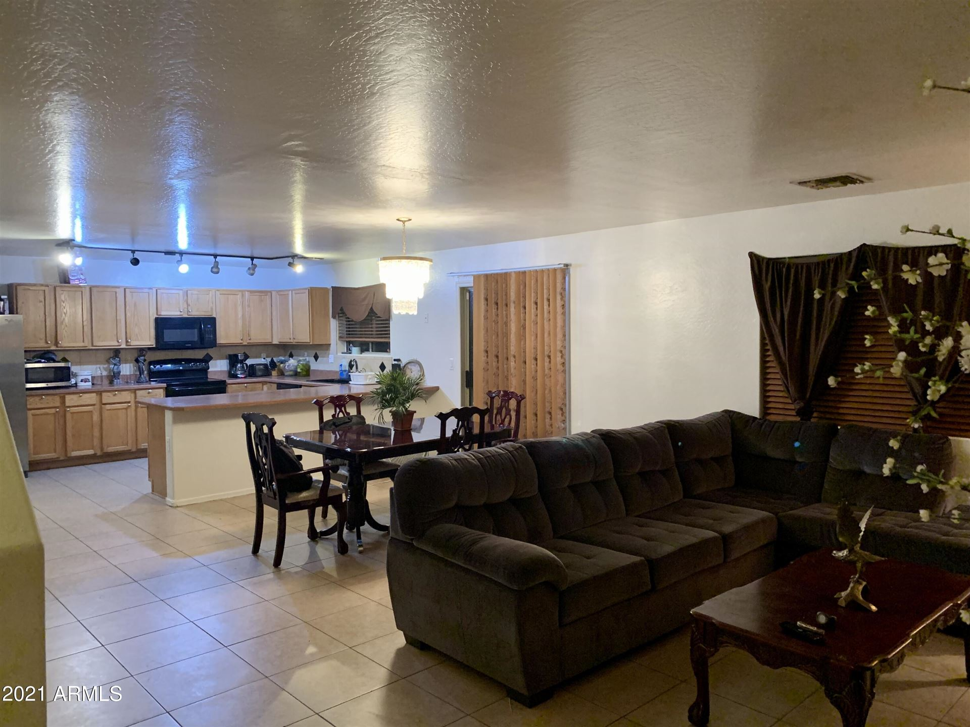 Photo of 10002 W CROWN KING Road, Tolleson, AZ 85353 (MLS # 6302136)