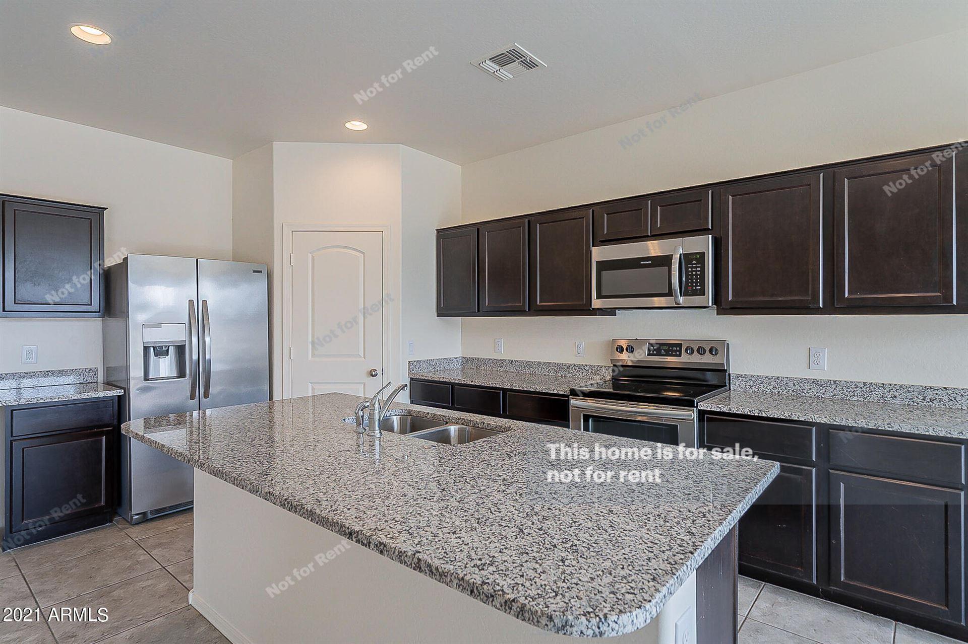 Photo of 37685 W AMALFI Avenue, Maricopa, AZ 85138 (MLS # 6296307)