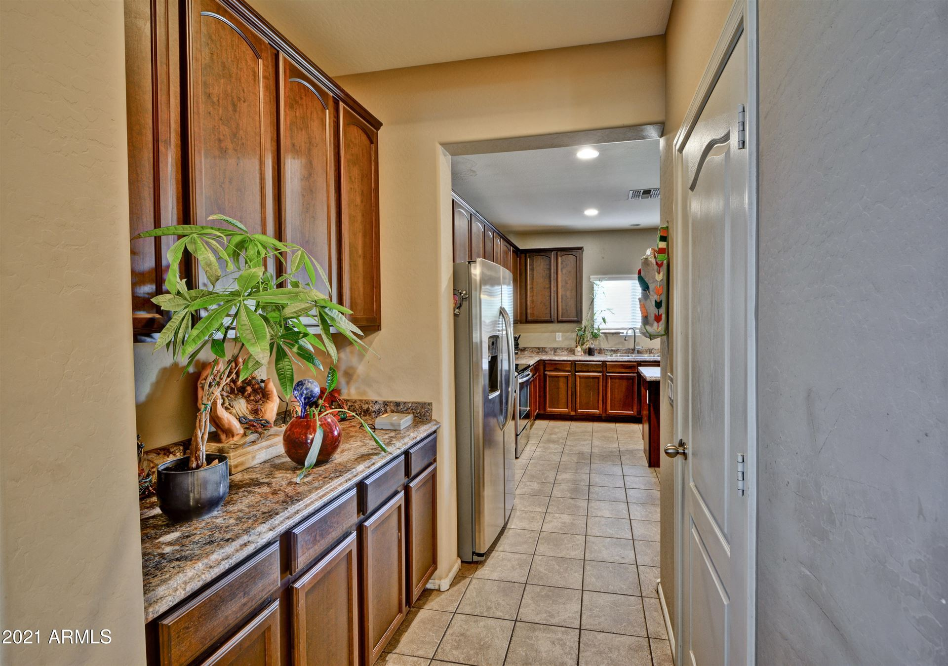 Photo of 8912 W CROWN KING Road, Tolleson, AZ 85353 (MLS # 6200429)
