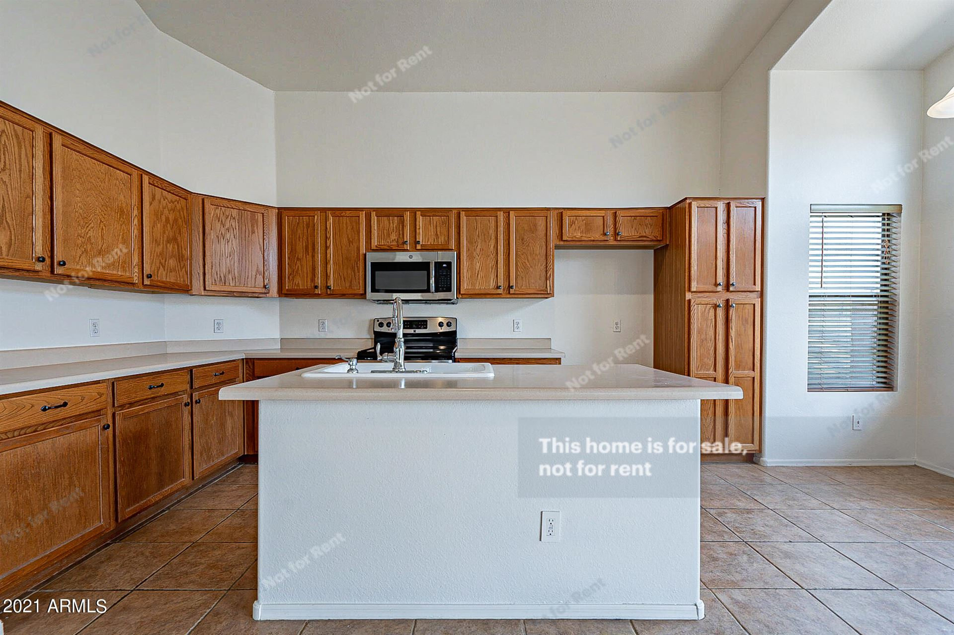 Photo of 1034 E PIMA Avenue, Apache Junction, AZ 85119 (MLS # 6289584)
