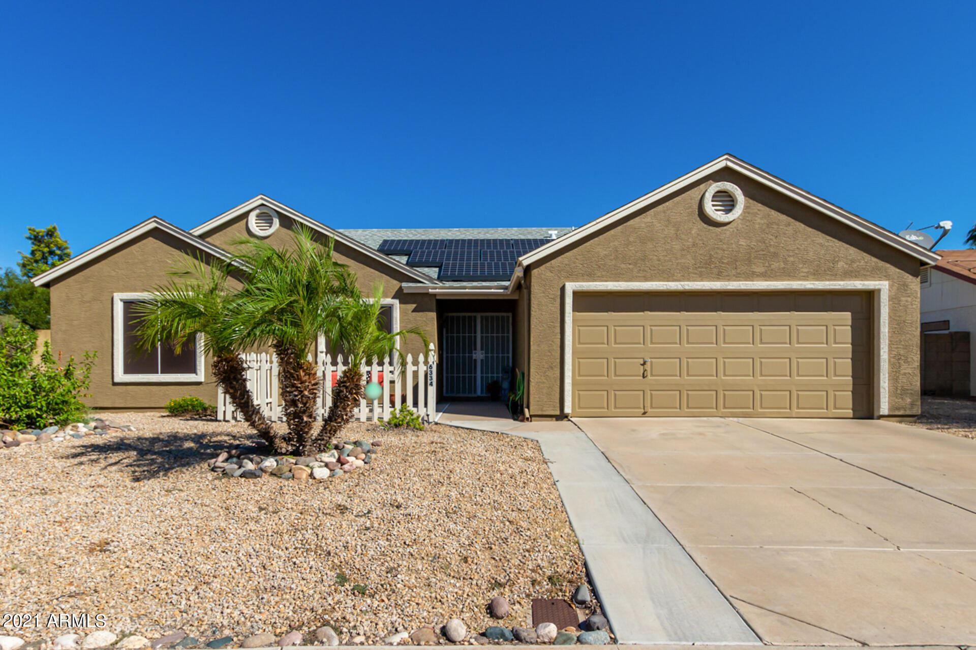 Photo of 6334 W MADRAS Lane, Glendale, AZ 85306 (MLS # 6307619)