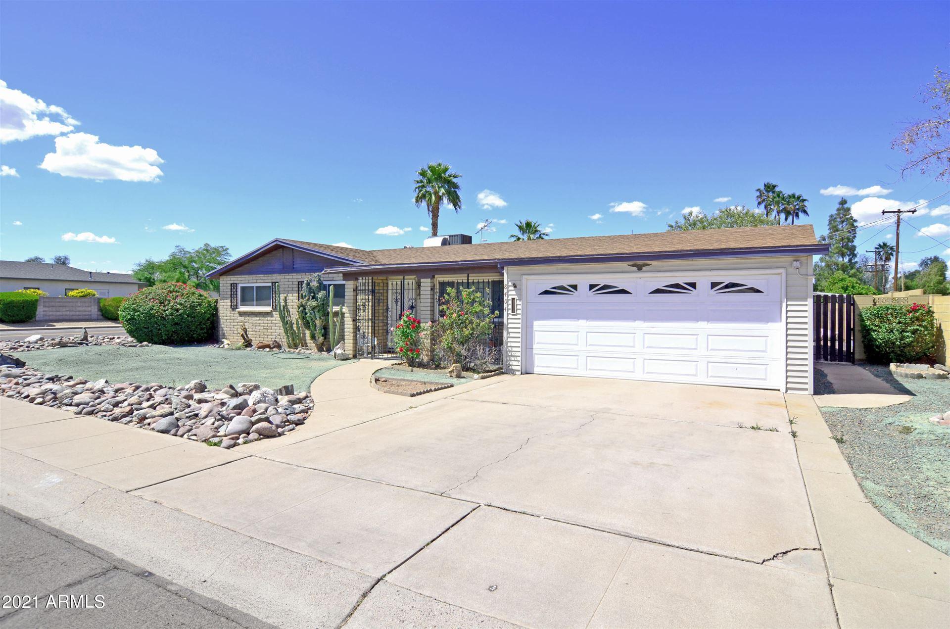 Photo of 8404 E THOMAS Road, Scottsdale, AZ 85251 (MLS # 6227693)
