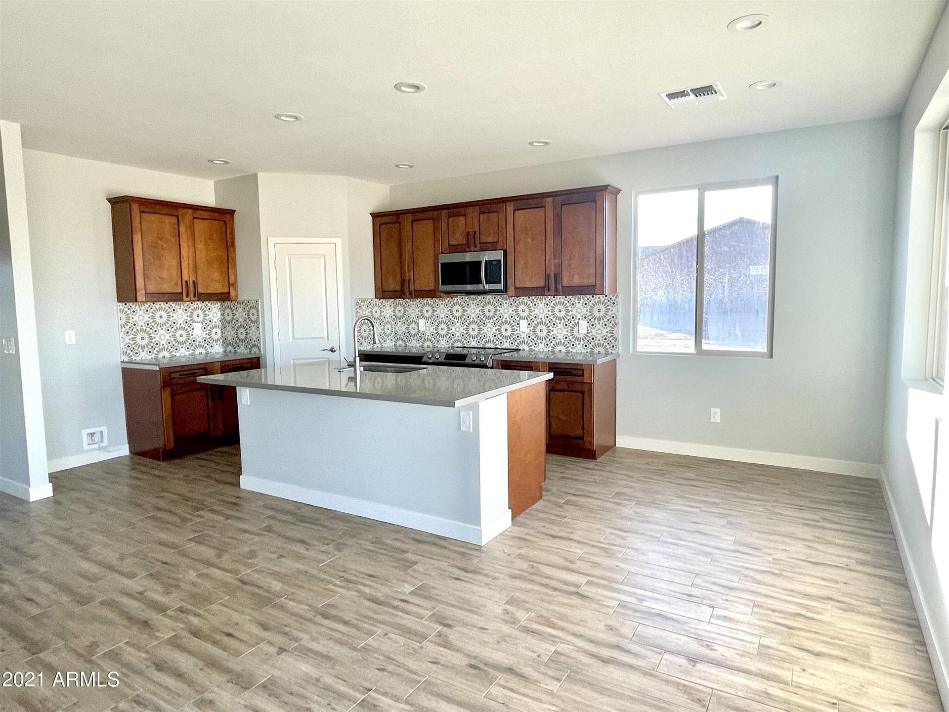 Photo of 25630 W GAMBIT Trail, Wittmann, AZ 85361 (MLS # 6300694)