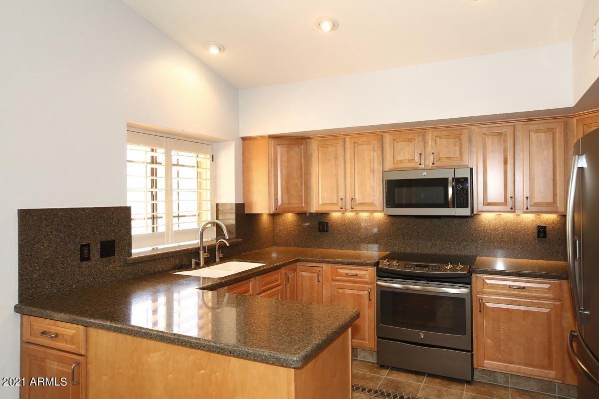 Photo of 10495 E DREYFUS Avenue, Scottsdale, AZ 85260 (MLS # 6200940)
