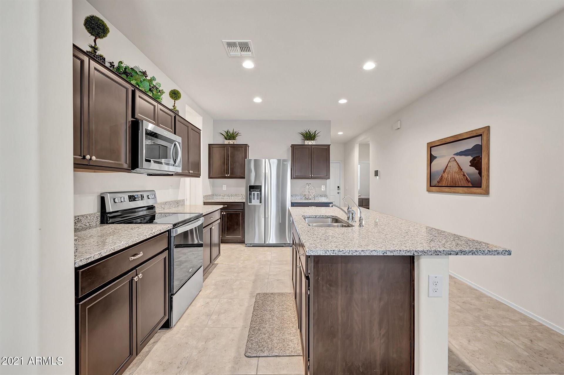 Photo of 36397 W Pampoloma Avenue, Maricopa, AZ 85138 (MLS # 6265965)