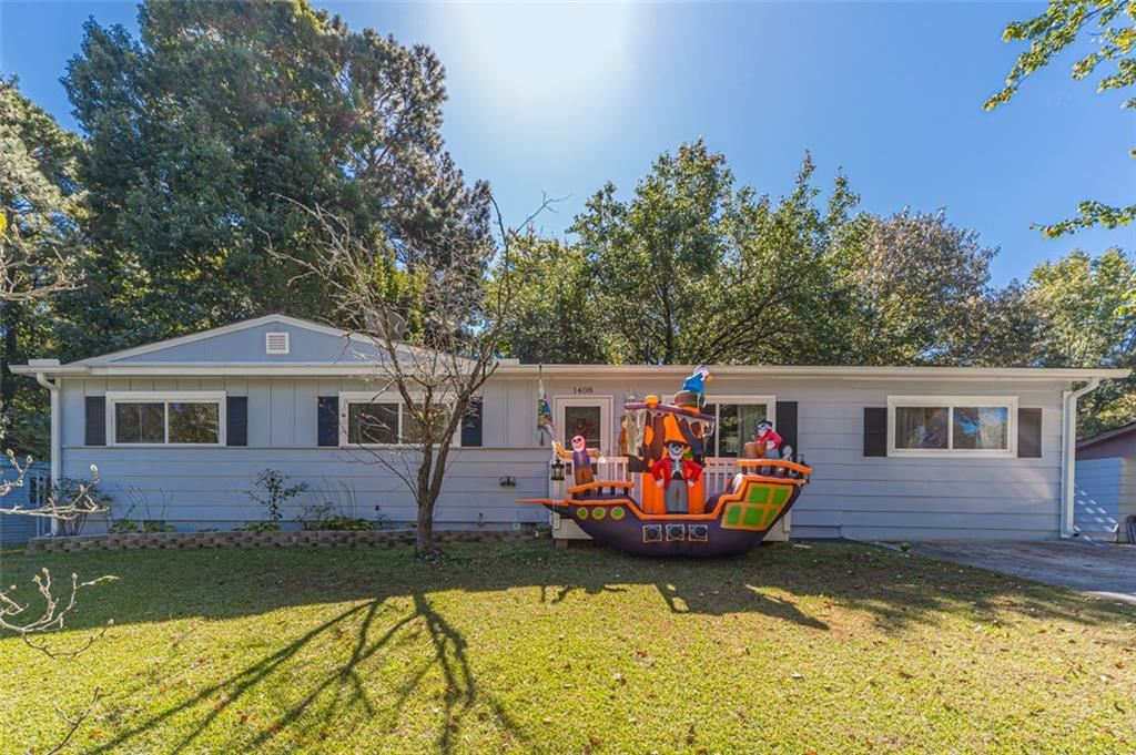 Photo of 1408 SYCAMORE Drive NW, Kennesaw, GA 30152 (MLS # 6960055)