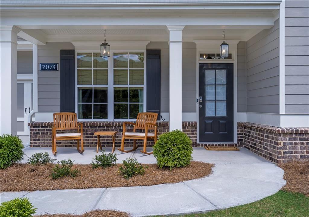 Photo of 7074 Tree House Way, Flowery Branch, GA 30542 (MLS # 6895177)