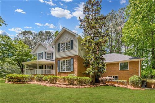 Photo of 1387 Oleander Drive SW, Lilburn, GA 30047 (MLS # 6882564)