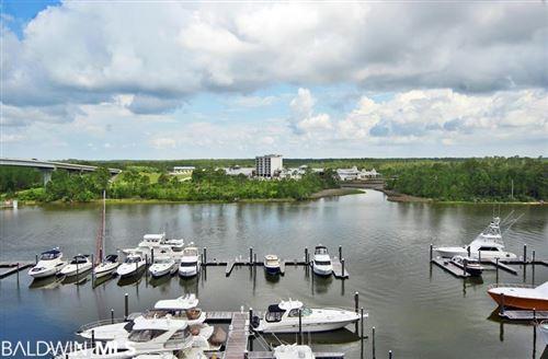 Photo of 4851 Wharf Pkwy #613, Orange Beach, AL 36561 (MLS # 301046)