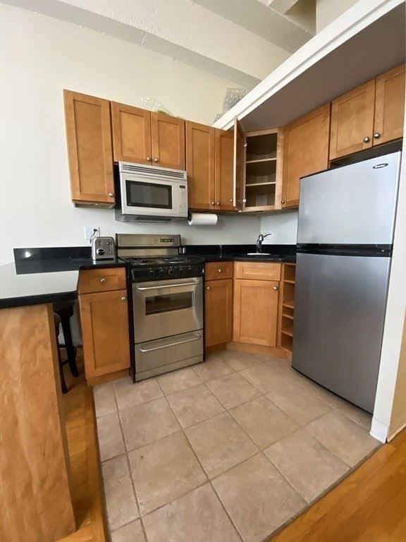 Photo of 12 Stoneholm St #406, Boston, MA 02115 (MLS # 72761368)