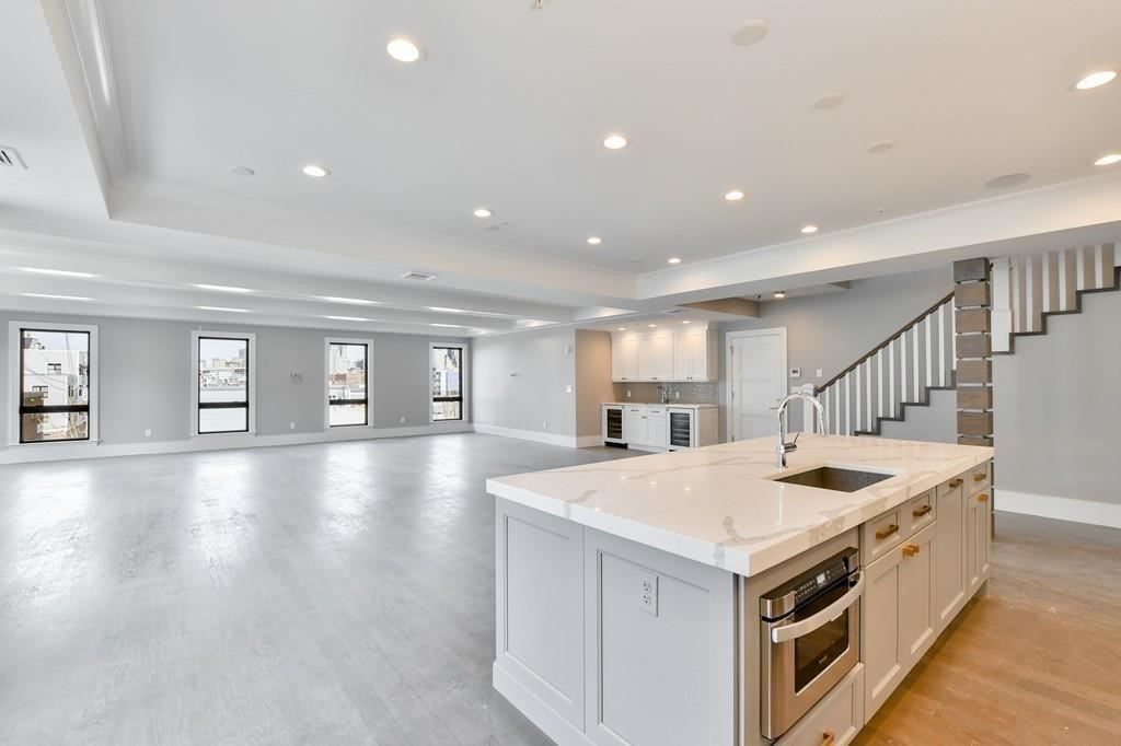 Photo of 377 W FIRST #8, Boston, MA 02127 (MLS # 72678800)