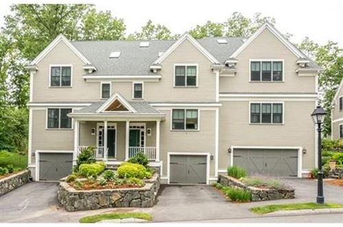 Photo of 102 Johnson Woods Dr #102, Reading, MA 01867 (MLS # 72685825)
