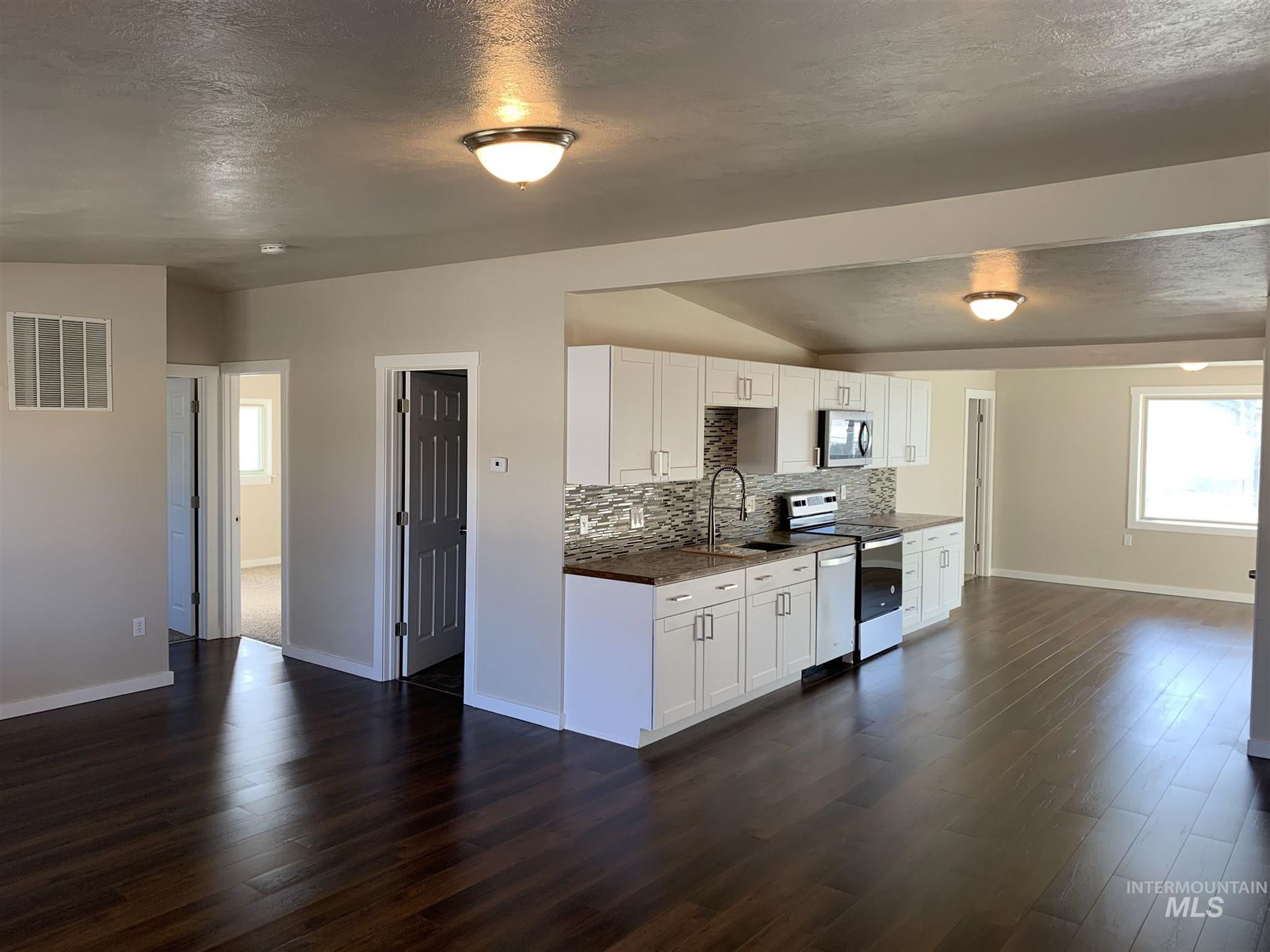 Photo of 411 Chestnut, Mountain Home, ID 83647 (MLS # 98799157)