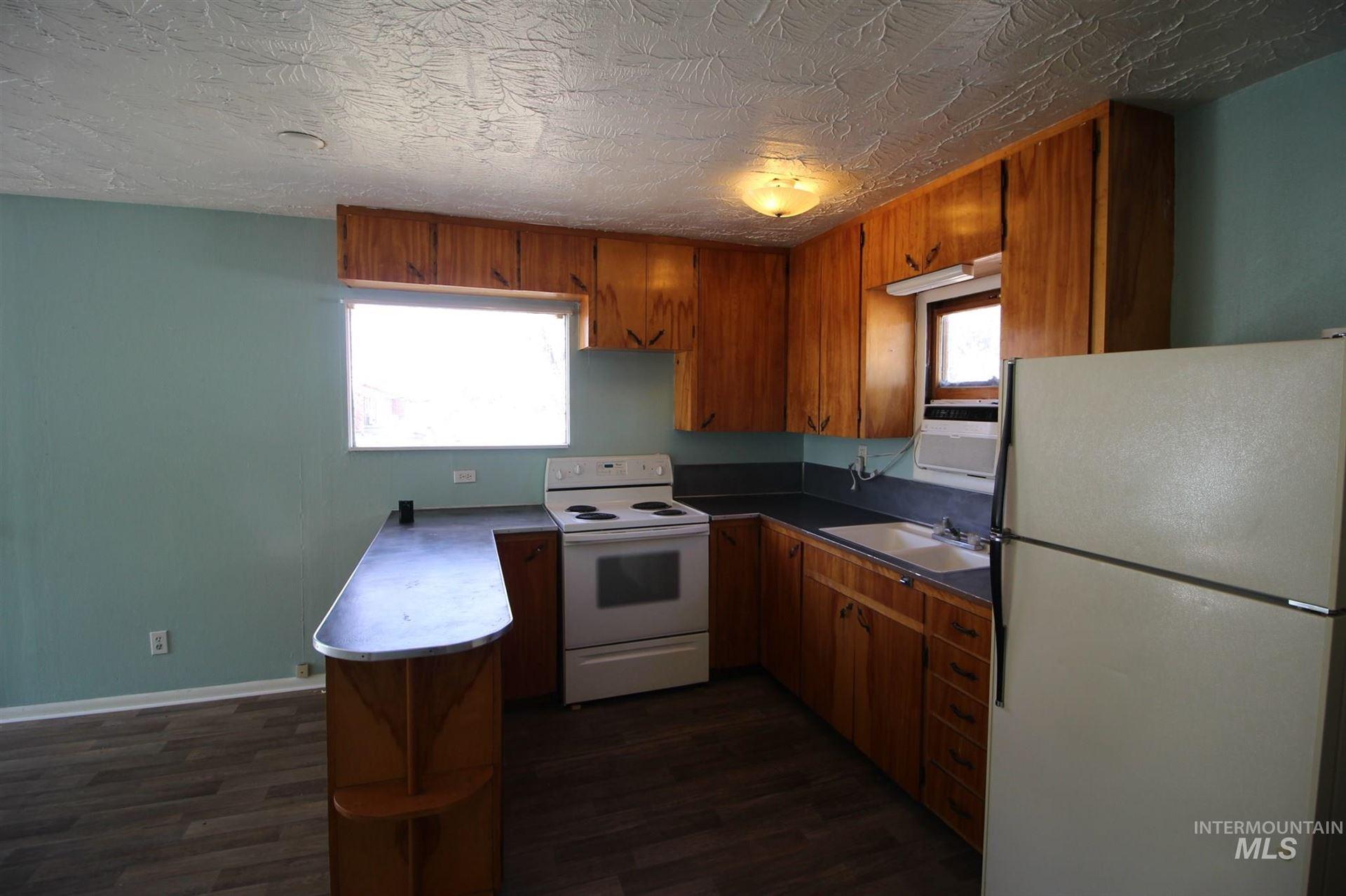 Photo of 860 N 3rd East, Mountain Home, ID 83647 (MLS # 98790646)