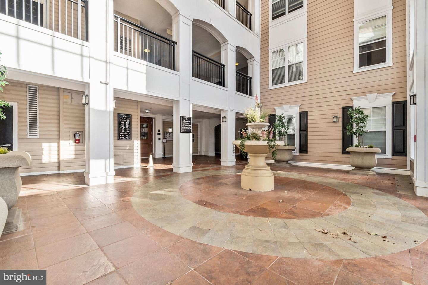 Photo of 501 HUNGERFORD DR #372, ROCKVILLE, MD 20850 (MLS # MDMC734000)