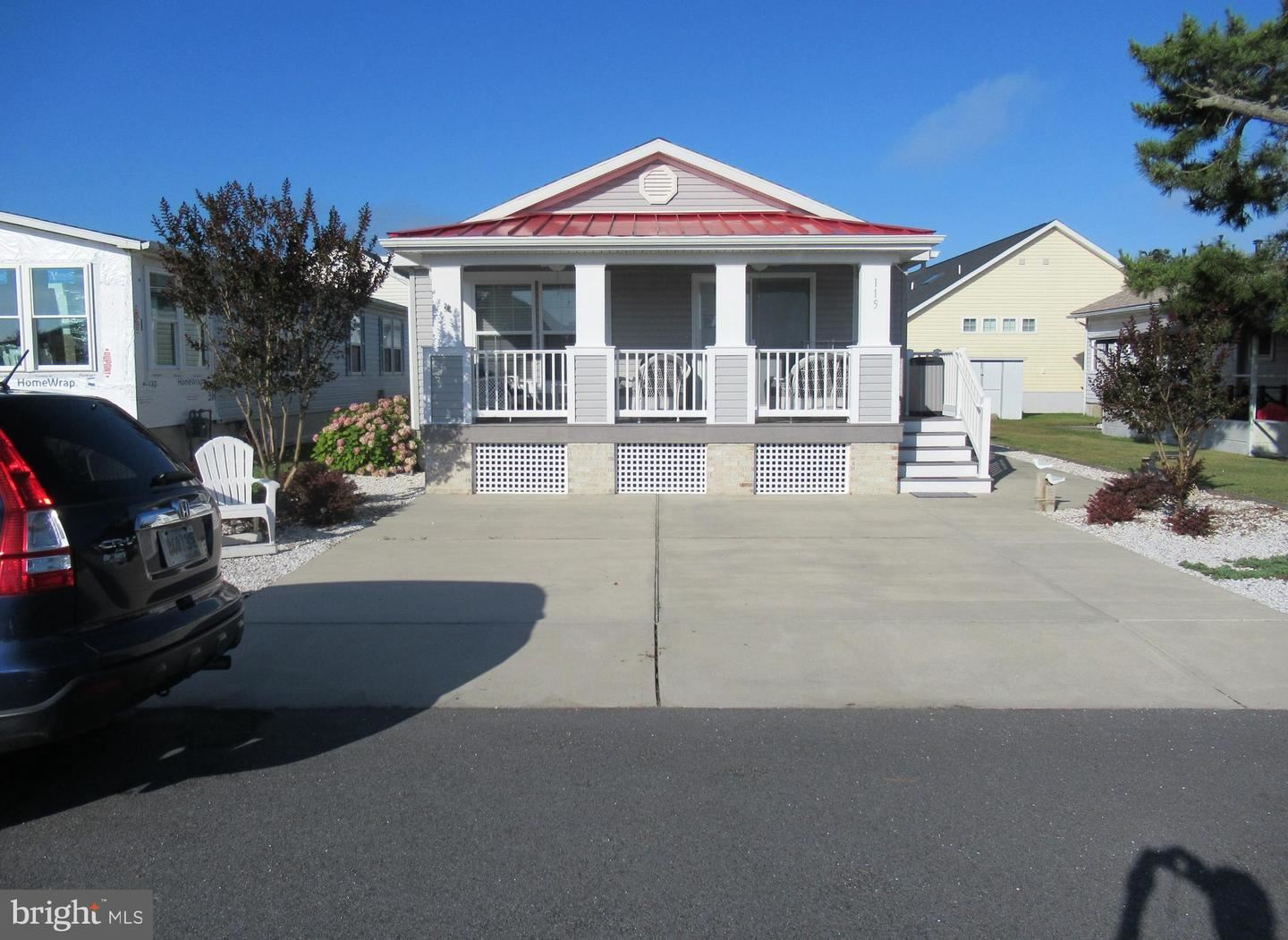 Photo of 115 CLAM SHELL RD, OCEAN CITY, MD 21842 (MLS # MDWO115042)