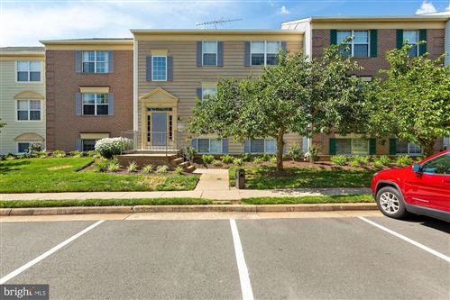 Photo of 1133 HUNTMASTER TER NE #301, LEESBURG, VA 20176 (MLS # VALO415074)