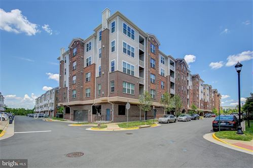 Photo of 13724 NEIL ARMSTRONG AVE #507, HERNDON, VA 20171 (MLS # VAFX1137130)