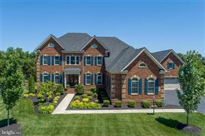 Photo of 23896 HEATHER MEADOW DR, ASHBURN, VA 20148 (MLS # VALO387152)
