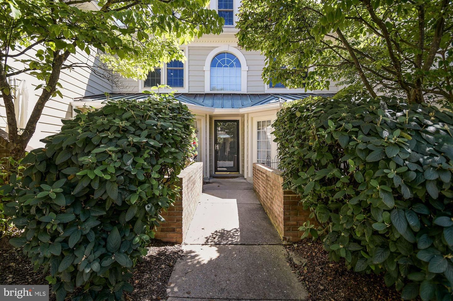 Photo of 10833 LUXBERRY DR #26, ROCKVILLE, MD 20852 (MLS # MDMC726156)