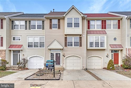 Photo of 7929 FLAGER CIR, MANASSAS, VA 20109 (MLS # VAPW486228)